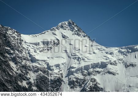 Awesome Mountains Landscape With Black White Snowy Mountain Top In Sunny Blue Sky. Minimalist Highla