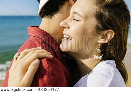 Happy Couple Hugging At Beach - Cropped Side View Of Wonderful Young Hispanic Woman Enjoying Life Wi