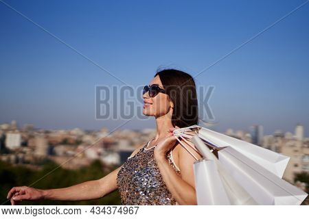 Retail, Consumerism Or Sale Concept: Beautiful Caucasian Fashionable Woman With White Shopping Bags