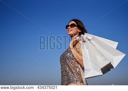 Retail, Consumerism Or Sale Concept - Happy Woman With Shopping Bags. Shopaholic Brunette Girl In Su