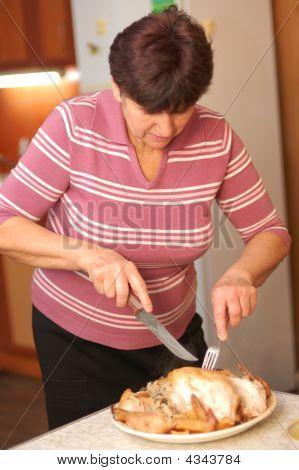 Woman Parts Fried Chicken At Kitchen