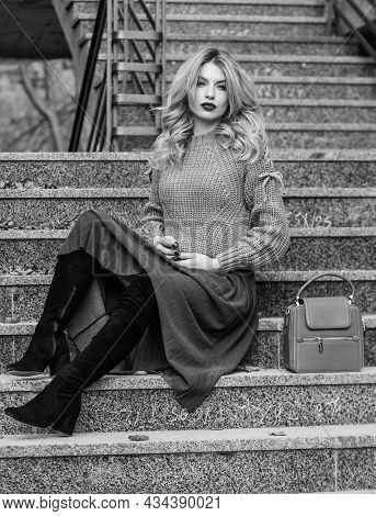 Totally Relaxed. Female Beauty. Fashion Model. Girl In Corrugated Skirt And Sweater. Pleated Trend.