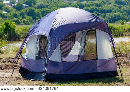 Tourist Tent In The Camp Of Tourists. Symbolic Travel And Adventure Background With Selective Focus