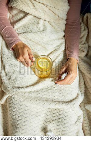 Top View Sick Woman Holding Mug Of Warm Sea Buckthorn Tea