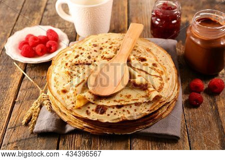 stack of crepe and jam