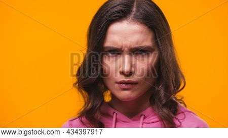 Grumpy Woman Frowning While Looking At Camera Isolated On Yellow