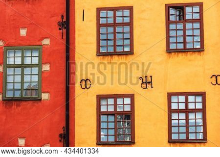old yellow house and old red house with windows