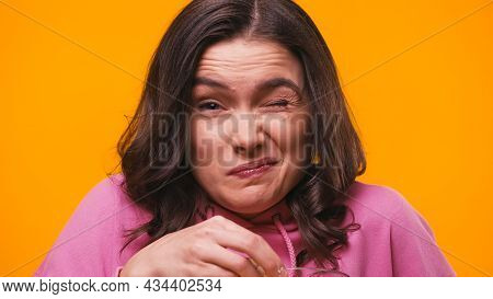 Frightened Woman Grimacing While Looking At Camera Isolated On Yellow