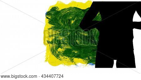 Mid section of silhouette of female handball player yellow and green paint brush strokes. sports and competition concept