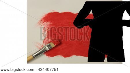 Mid section of silhouette of female handball player against red paint stain and paint brush. sports and competition concept