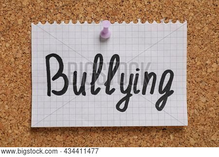 Note With Phrase Stop Bullying Pinned To Cork Board, Closeup