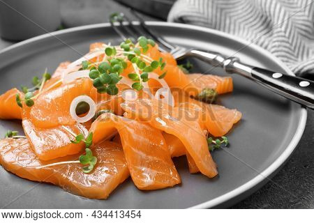 Salmon Carpaccio With Capers, Onion And Microgreens On Plate, Closeup