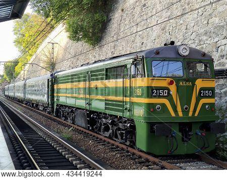 Madrid, Spain - September 28, 2021. Felipe Ii Tourist Train. Locomotive 2150 At The Príncipe Pío Sta
