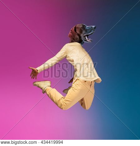Contemporary Collage With Young Man, Hip Hop Dancer Headed Of Dogs Head Dancing Isolated Over Gradie