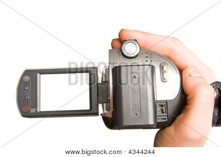 Manual video camera in human hand. close up poster