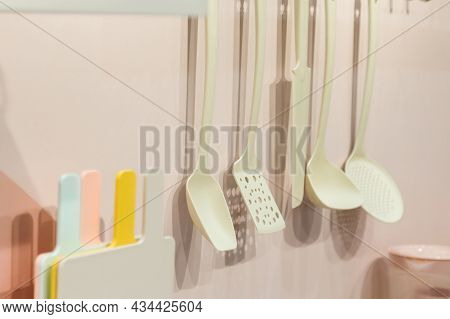Kitchenware Tools Household Goods Plastic Hang On The Wall, Kitchen Interior In Pastel Trending Colo