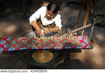 Cambodian Women People Making Fruit Juice And Palm Sugar Cakes From Sugar Palm Plant Or Toddy Tree F
