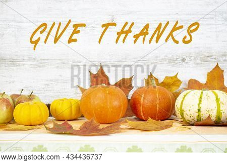 Give Thanks Text Handwritten. Thanksgiving Day With Fruits And Vegetables On The Table. Autumn Harve