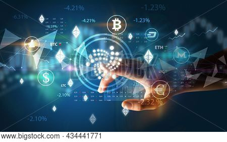 Business person hand pushing currency symbol on multimedia touch screen