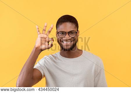 Im Okay. Excited African American Man Gesturing Ok Sign And Smiling To Camera, Standing Over Yellow