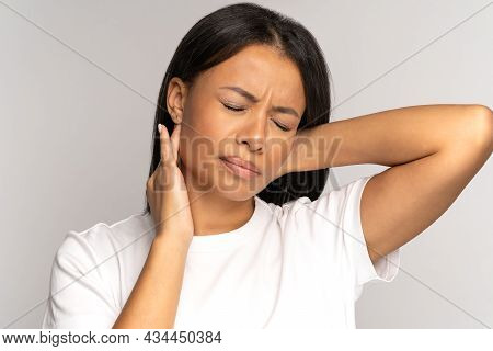 Tired Girl Suffer From Neck Pain, Pinched Nerve In Her Back. African Woman Has Spinal Problem, Muscl