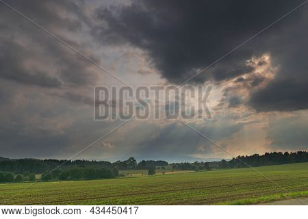 Fields And Meadows In The Plain. Hazy Peaks Of The Nearby Karkonosze Mountains On The Horizon. View