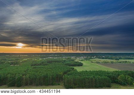 A Vast Plain, Farmland And Meadows Crossed By Roads. Clumps Of Green Trees Are Visible. In The Dista