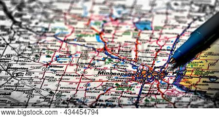 Closeup map of city Minneapolis for travel destination driving plan with pen for traveling