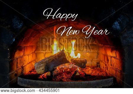 Coals Burning In The Fireplace. Christmas Concept. Burning Fireplace For Christmas. Festive Fireplac