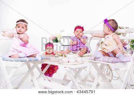 Adorable babies group having tea party