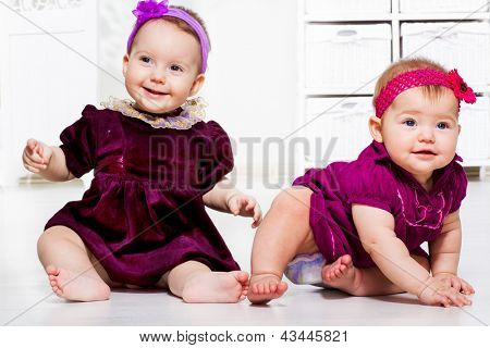 Two baby girls in dresses
