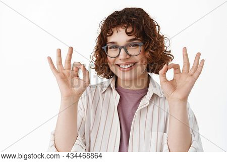 Smiling Cute Queer Girl In Glasses Showing Okay Ok Gesture, Looking Assured And Confident In Her Cho