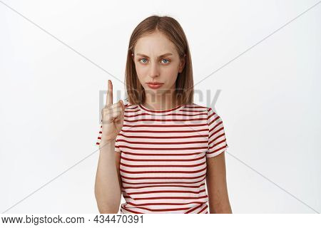 Upset Blond Girl Pointing Finger Up, Frowning Displeased, Dislike Smth, Express Her Negative Opinion