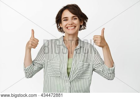 Very Good. Smiling Satisfied Modern Woman, Showing Thumbs Up In Approval, Like And Agree, Recommend,