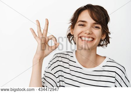 Close Up Of Happy Smiling Woman Showing Ok, Okay Sign In Approval, Like And Agree, Praise Excellent