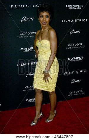 """LOS ANGELES - MARCH 18: Angela Bassett arrives at the premiere of """"Olympus Has Fallen"""" at the ArcLight Hollywood Theatre in Los Angeles, CA on March 18, 2013."""