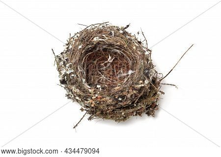 Empty Bird's Nest Made Of Straw, Sticks And Feathers Isolated On White Background, Top View, Soft Fo
