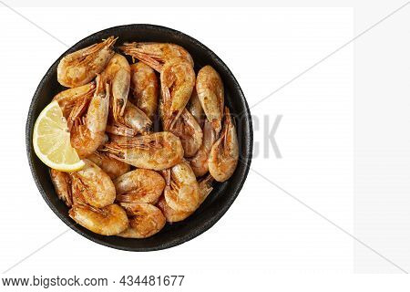 Appetizing Shrimps With Lemon In A Portioned Cast Iron Pan. Healthy Food And Diet. Isolated On White