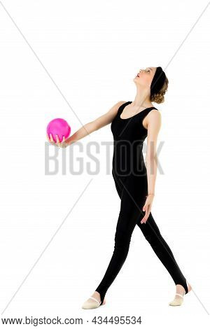 Young Teen Girl Athlete Exercising With Pink Ball. Attractive Girl Gymnast In Black Sportswear And H