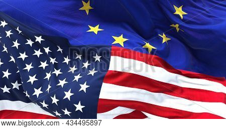 The Flags Of The United States And The European Union On Top Of Each Other. International Relations