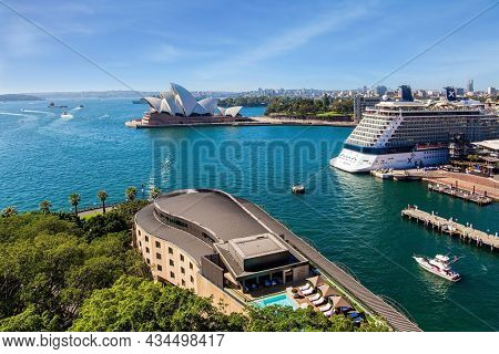 SYDNEY, AUSTRALIA - MARCH 30, 2018: The famous Sydney Harbor. Huge white ocean liner at the quays. Boat trip on a tourist boat along the shores of the port. The famous opera house