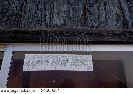 Jeffrey City, Wyoming - August 5, 2021: Old Sticker Advertising Kodak Kodacolor Film Developing For