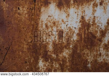 Old Rusty Iron Sheet Covered With Brown Rust And Grey Paint. Background And Wallpaper Picture. Corro