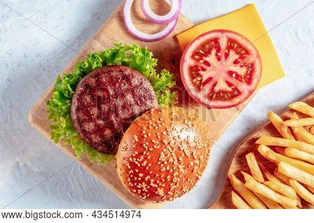 Burger Ingredients With French Fries. Hamburger Beef Patty Steak With A Sesame Bun And Vegetables, T