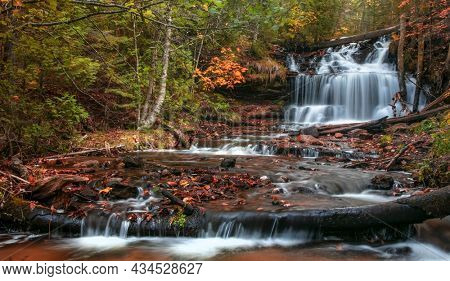 Scenic Wagner water falls in Michigan upper peninsula during autumn time