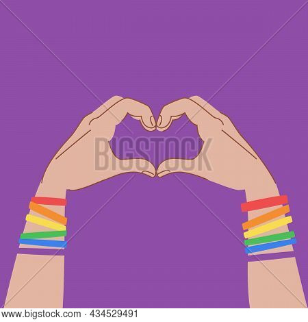 Hands In Heart Sign Isolated On Purple Background. Hands With Bracelets In Lgbt Flag Colors. Lgbt Po