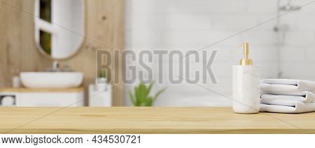 Wooden Table Top With Ceramic Shampoo Bottle And Towels Over Bathroom Interior Background