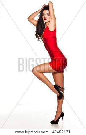 Beautiful sexy woman wearing red dress and black high heels shoes