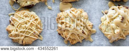 Top Down Narrow View Of Maple Vermont Cookies Drizzled With Maple Icing.
