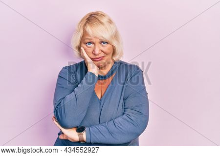 Middle age blonde woman wearing casual clothes thinking looking tired and bored with depression problems with crossed arms.